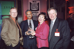 Arjuna's Steve Caughey and Santosh Shrivastava with BCS President Alastair Macdonald and broadcaster Kate Bellingham